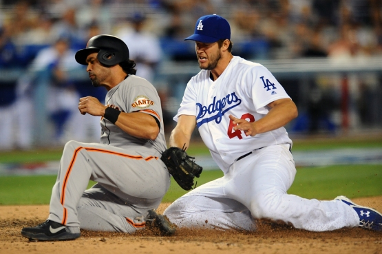 Angel Pagan scores on a wild pitch by Clayton Kershaw in the sixth inning.