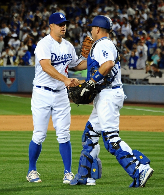Joe Blanton and A.J. Ellis congratulate each other after the game.
