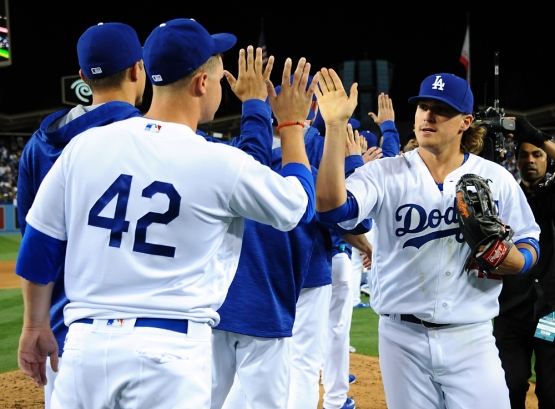 Kike Hernandez high-fives his teammates after the Dodgers beat the Giants, 7-3.
