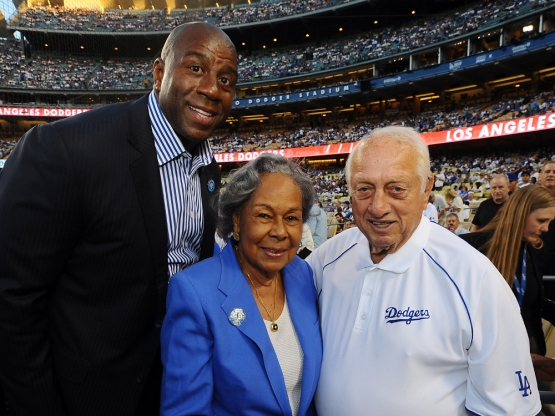 Magic Johnson, Rachel Robinson and Tommy Lasorda pose for a photo before the game.
