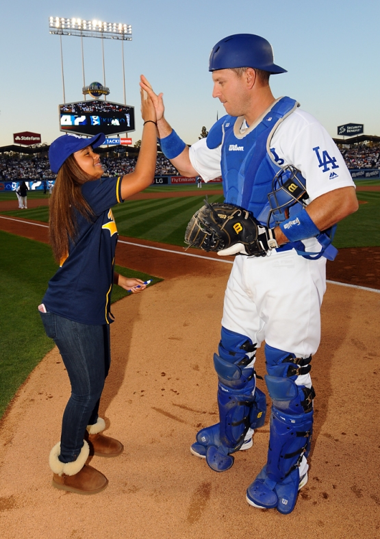 A.J. Ellis high-fives a Kids Taking The Field participant.