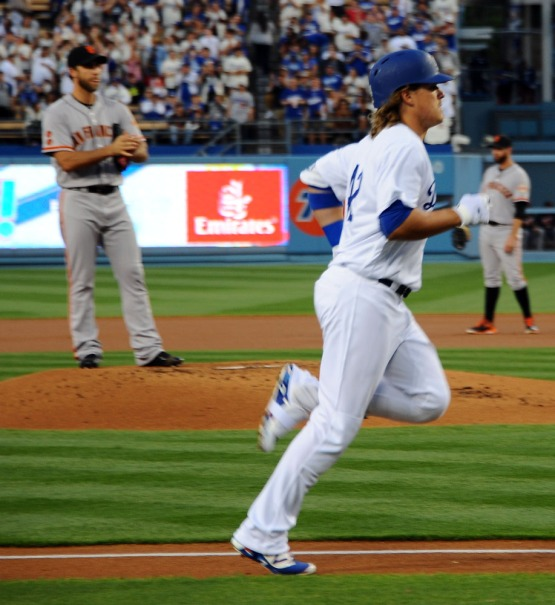 Kike Hernandez heads for home after his first inning home run off of Giants starter Madison Bumgarner.