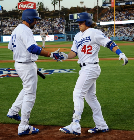 Kike Hernandez is congratulated by Adrian Gonzalez after his home run.