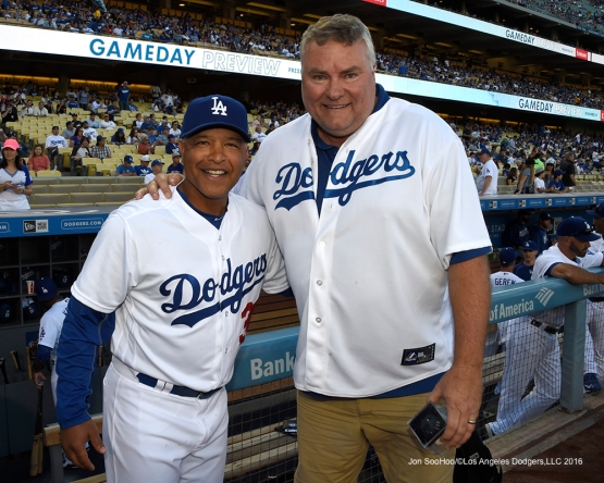 Coffee Bean President and CEO, John Fuller poses with Dave Roberts before Los Angeles Dodgers game against San Francisco Giants Saturday, April 16, 2016 at Dodger Stadium.