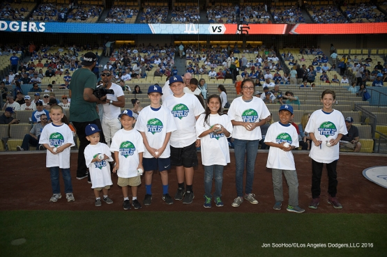 Kids Taking the Field pose prior to Los Angeles Dodgers game against San Francisco Giants Saturday, April 16, 2016 at Dodger Stadium.