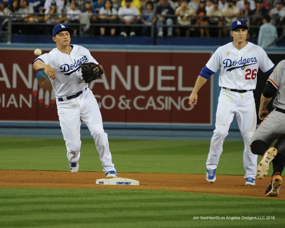 Los Angeles Dodgers Corey Seager turns double play against San Francisco Giants Saturday, April 16, 2016 at Dodger Stadium.
