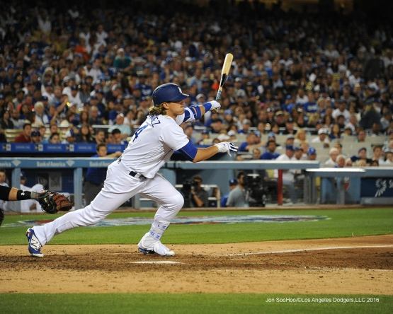 Los Angeles Dodgers Kike Hernandez scores Justin Turner against San Francisco Giants Saturday, April 16, 2016 at Dodger Stadium.