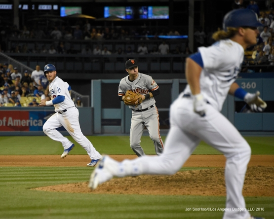 Yasmani Grandal takes third in the 9th against San Francisco Giants Saturday, April 16, 2016 at Dodger Stadium.