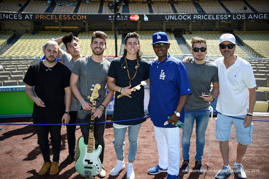 Los 5 poses with Manny Mota prior to Los Angeles Dodgers game against San Francisco Giants Sunday, April 17, 2016 at Dodger Stadium. The Dodgers beat the Giants 3-1.