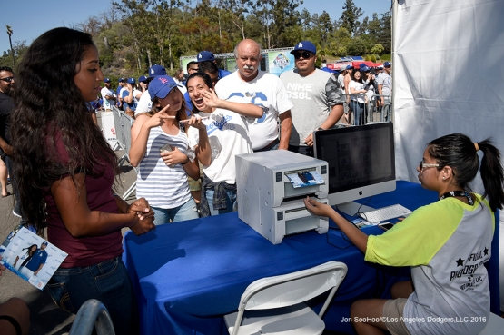 Great Los Angeles Dodger fans pick up their Adrian Gonzalez photos from Blue Prints at Viva Los Dodgers prior to game against San Francisco Giants Sunday, April 17, 2016 at Dodger Stadium. The Dodgers beat the Giants 3-1.
