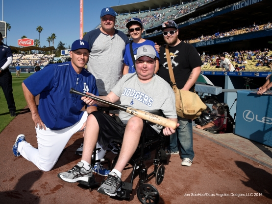 A.J.Ellis poses with a Great Los Angeles Dodger fan prior to game against San Francisco Giants Sunday, April 17, 2016 at Dodger Stadium. The Dodgers beat the Giants 3-1.
