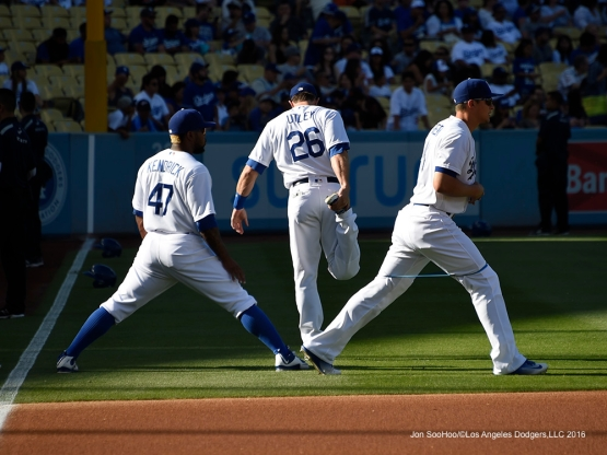 Howie Kendrick, Chase Utley and Corey Seager warm up before game against San Francisco Giants Sunday, April 17, 2016 at Dodger Stadium. The Dodgers beat the Giants 3-1.