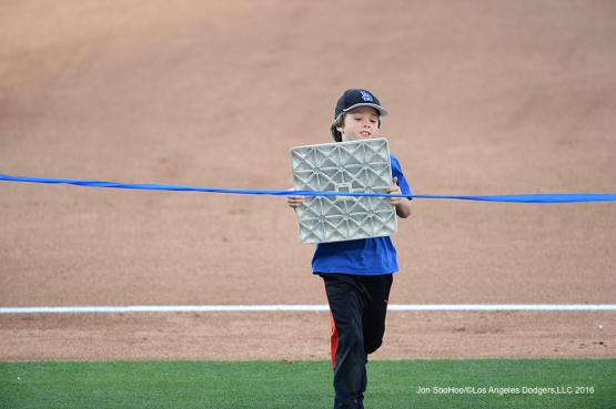 Great Los Angeles Dodgers fan wins the race between innings of game against San Francisco Giants Sunday, April 17, 2016 at Dodger Stadium. The Dodgers beat the Giants 3-1.