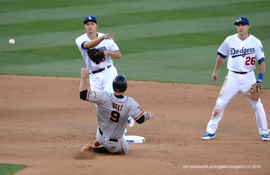Los Angeles Dodgers Corey Seager turns double play against San Francisco Giants Sunday, April 17, 2016 at Dodger Stadium. The Dodgers beat the Giants 3-1.