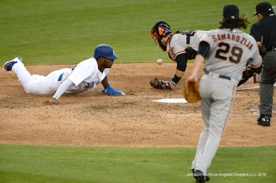Los Angeles Dodgers Yasiel Puig is safe at home during game against San Francisco Giants Sunday, April 17, 2016 at Dodger Stadium. The Dodgers beat the Giants 3-1.