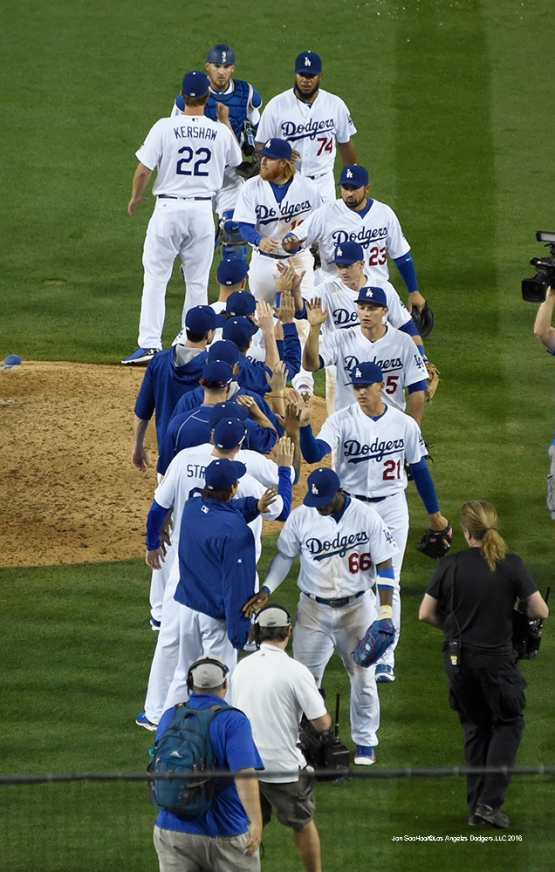 Los Angeles Dodgers high five after win against San Francisco Giants Sunday, April 17, 2016 at Dodger Stadium. The Dodgers beat the Giants 3-1.