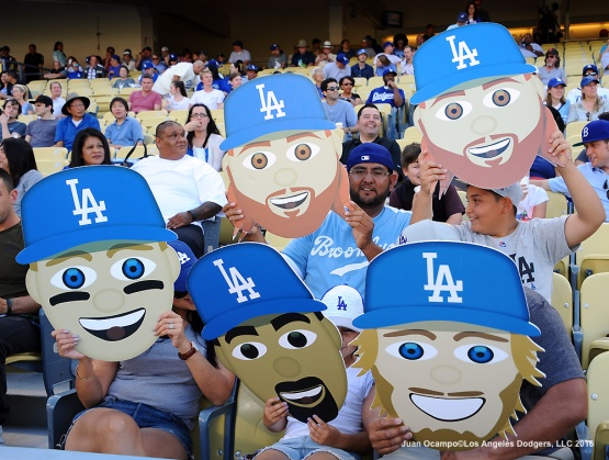 Fans hold up emoji's of Dodger players before the game against the San Francisco Giants.