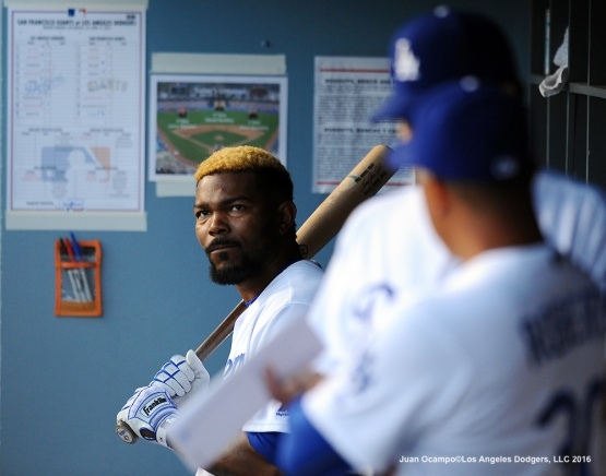 Howie Kendrick waits for his turn to bat.