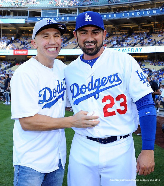Professional boxer Gennady Golovkin (left) and Adrian Gonzalez pose for a photo.