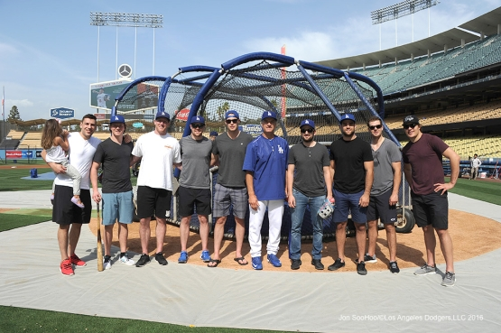 Los Angeles Kings pose with coach Bob Geren prior to game against Miami Marlins Tuesday, April 26, 2016 at Dodger Stadium.
