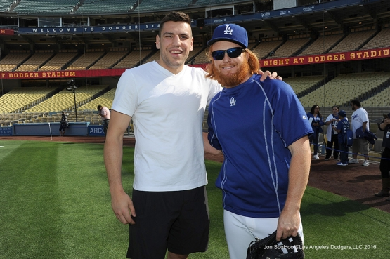 Los Angeles Kings Milan Lucic poses with Justin Turner prior to game against Miami Marlins Tuesday, April 26, 2016 at Dodger Stadium.
