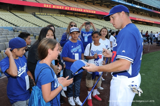 A.J. Ellis signs for fans  prior to game against Miami Marlins Tuesday, April 26, 2016 at Dodger Stadium.