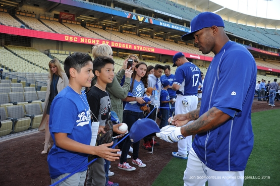 Howie Kendrick signs for fans prior to game against Miami Marlins Tuesday, April 26, 2016 at Dodger Stadium.