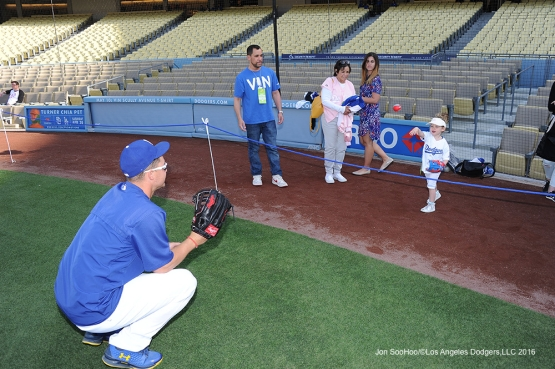 Joc Pederson plays catch with a Great Los Angeles Dodger fan prior to game against Miami Marlins Tuesday, April 26, 2016 at Dodger Stadium.