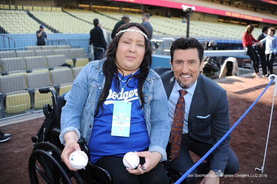 Nomar Garciaparra poses with a Great Los Angeles Dodger fan prior to game against Miami Marlins Tuesday, April 26, 2016 at Dodger Stadium.