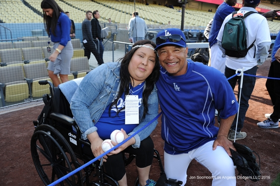 Dave Roberts poses with Great Los Angeles Dodger fan prior to game against Miami Marlins Tuesday, April 26, 2016 at Dodger Stadium.