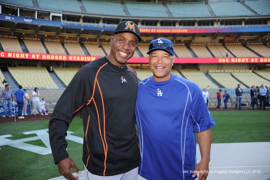 Barry Bonds poses with Dave Roberts prior to game against Miami Marlins Tuesday, April 26, 2016 at Dodger Stadium.