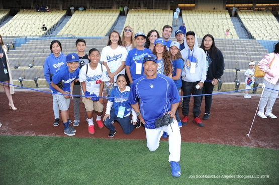 Dave Roberts poses with Los Angeles Dodgers Foundation guests prior to game against Miami Marlins Tuesday, April 26, 2016 at Dodger Stadium.