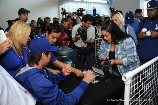 Kenta Maeda signs for fans donating to earthquake relief prior to game against Miami Marlins Tuesday, April 26, 2016 at Dodger Stadium.