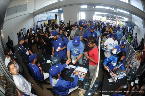Dave Roberts, Kenta Maeda, Yasiel Puig and Jaime Jarrin sign for fans  prior to game against Miami Marlins Tuesday, April 26, 2016 at Dodger Stadium.