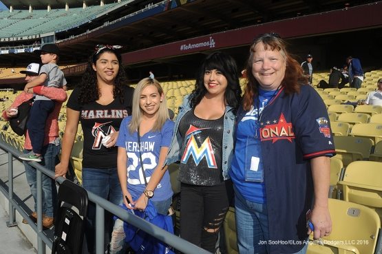 Great Los Angeles Dodger fans and two more pose prior to game against Miami Marlins Tuesday, April 26, 2016 at Dodger Stadium.