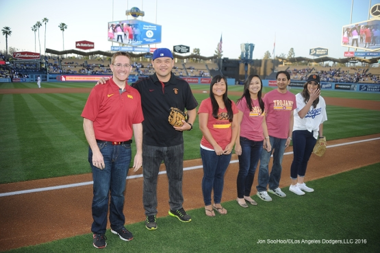 USC Night representatives on the first base line prior to game against Miami Marlins Tuesday, April 26, 2016 at Dodger Stadium.