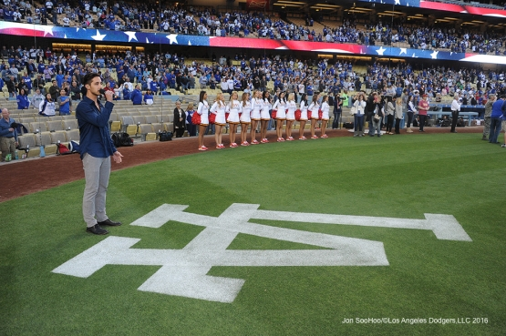 USC Night representative Michael Mancuso sings the national anthem prior to the Los Angeles Dodgers-Miami Marlins game  Tuesday, April 26, 2016 at Dodger Stadium.
