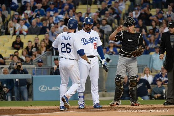 Chase Utley scores against Miami Marlins Tuesday, April 26, 2016 at Dodger Stadium.