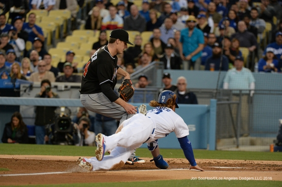 Justin Turner dives home safely against Miami Marlins Tuesday, April 26, 2016 at Dodger Stadium.