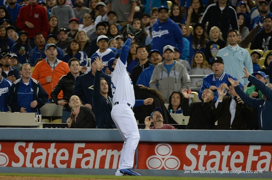 Los Angeles Dodgers Adrian Gonzalez pulls in fly ball during game against Miami Marlins Tuesday, April 26, 2016 at Dodger Stadium.