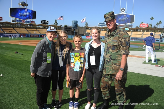 Retired Sergeant, Thomas Baker poses with his family prior to game against Miami Marlins Wednesday, April 27, 2016 at Dodger Stadium.