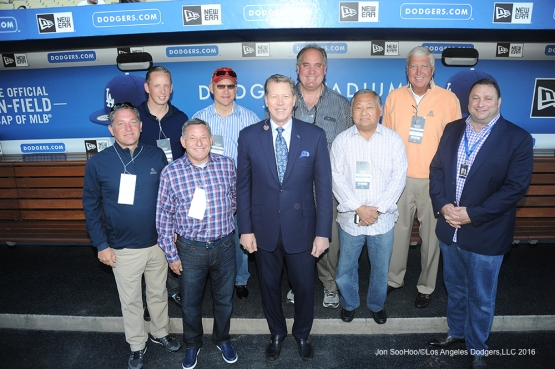 Guests of Mark Walter pose with Orel Hershiser prior to game against Miami Marlins Wednesday, April 27, 2016 at Dodger Stadium.