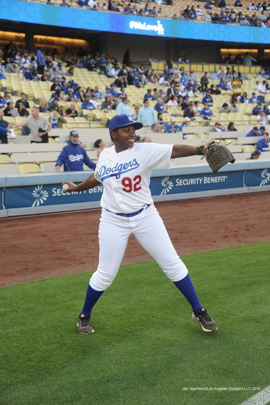 Los Angeles Dodgers batgirl warms up prior to game against Miami Marlins Wednesday, April 27, 2016 at Dodger Stadium.