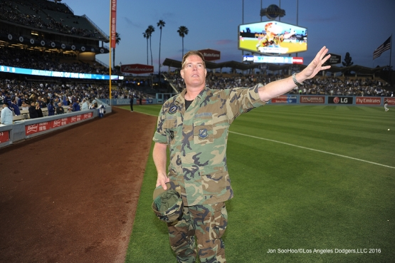 Retired Sergeant, Thomas Baker waves to the crowd during game against Miami Marlins Wednesday, April 27, 2016 at Dodger Stadium.