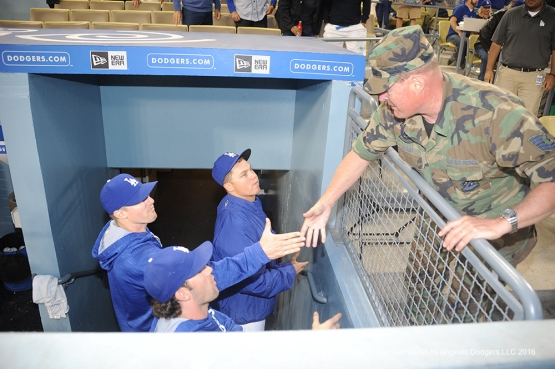 Retired Sergeant, Thomas Baker shakes hands with members of the Dodgers during game against Miami Marlins Wednesday, April 27, 2016 at Dodger Stadium.