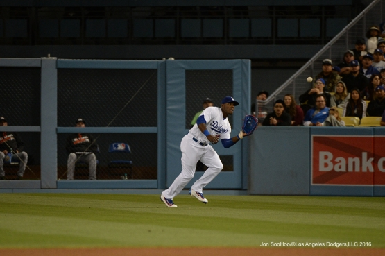 Los Angeles Dodgers Yasiel Puig runs down ball against Miami Marlins Wednesday, April 27, 2016 at Dodger Stadium.