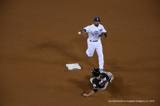 Los Angeles Dodgers Howie Kendrick throws to first against Miami Marlins Wednesday, April 27, 2016 at Dodger Stadium.