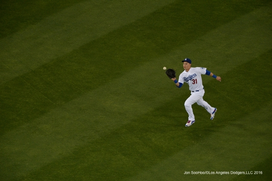 Los Angeles Dodgers Joc Pederson runs down ball against the Miami Marlins Wednesday, April 27, 2016 at Dodger Stadium.