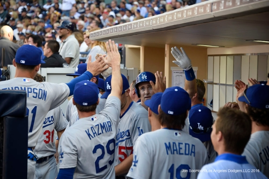 Los Angeles Dodgers Chase Utley is greeted by teammates in the dugout after scoring during game against the San Diego Padres Monday, April 4, 2016 at Petco Park in San Diego,California. The Dodgers beat the Padres 15-0