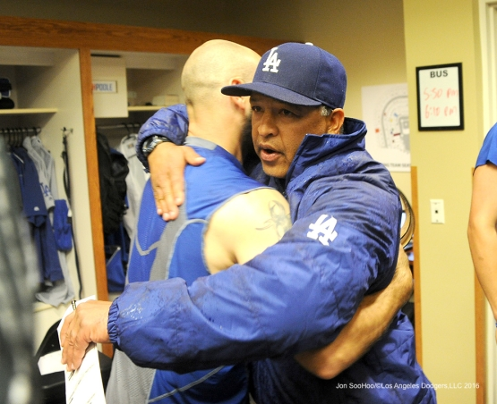 Los Angeles Dodgers Dave Roberts hugs reliever Chris Hatcher after game against the San Francisco Giants Saturday, April 9, 2016 at AT&T Park in San Francisco,California. The Dodgers beat the Giants 3-2.